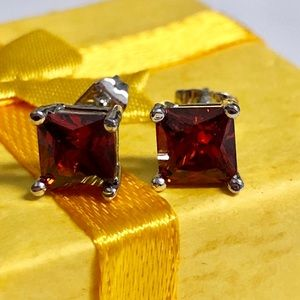 Ruby and gold plated stud earrings